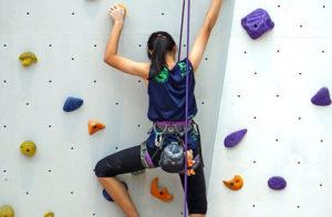 Photo of girl indoor rock climbing