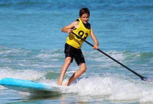 Photo of boy on a stand up paddle board