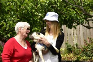 Photo of a Kingborough Volunteer with her client and client's dog