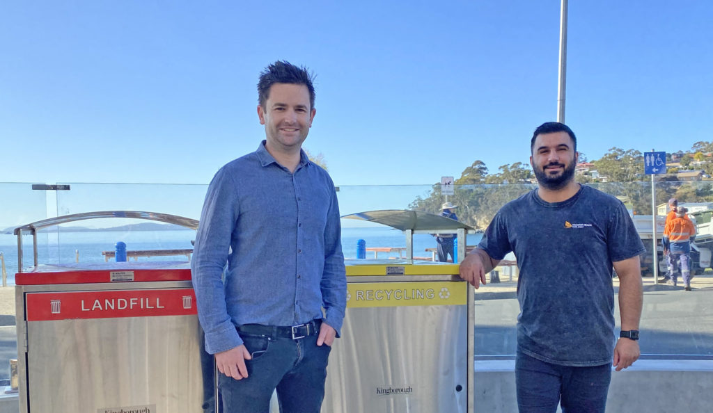 Photo of the Mayor of Kingborough Cr Dean Winter at new public recycling bins at Kingston Beach, with Youssef Assi, local business owner