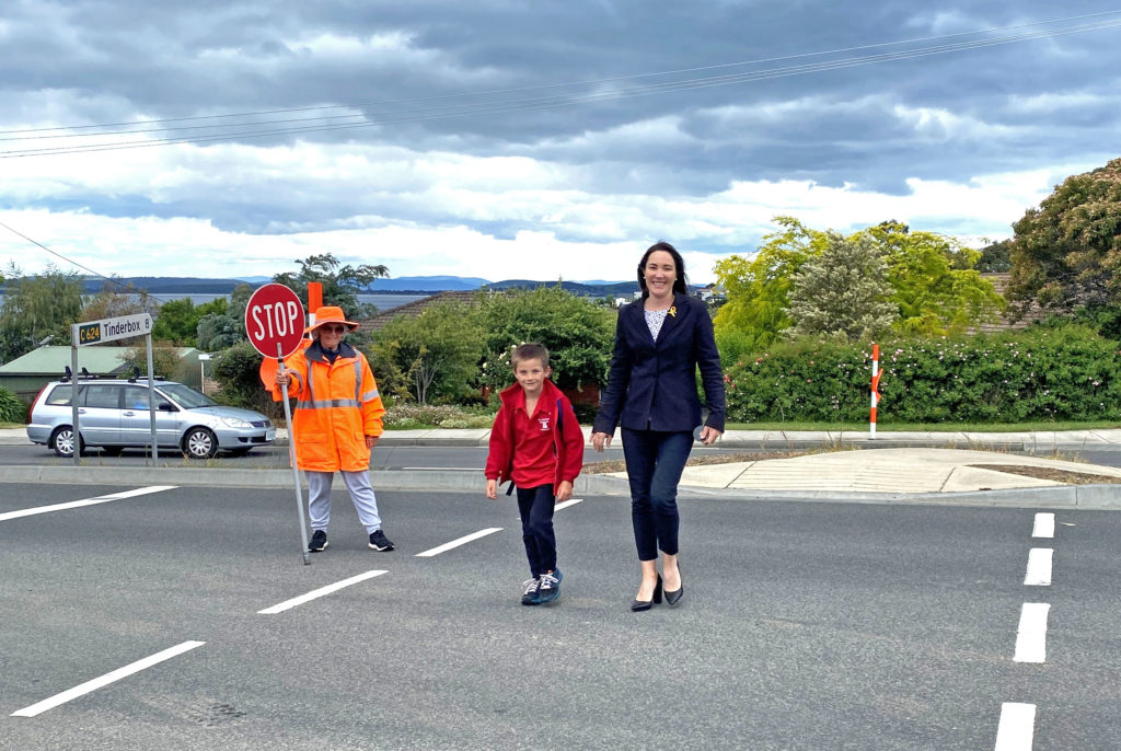 Photo of Cr Westwood and son Cooper crossing the road after school